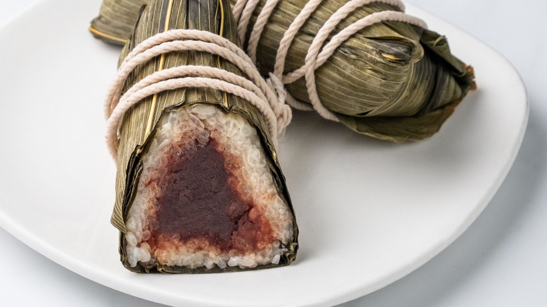 Red Bean Sticky Rice Wrap on a white plate, close up