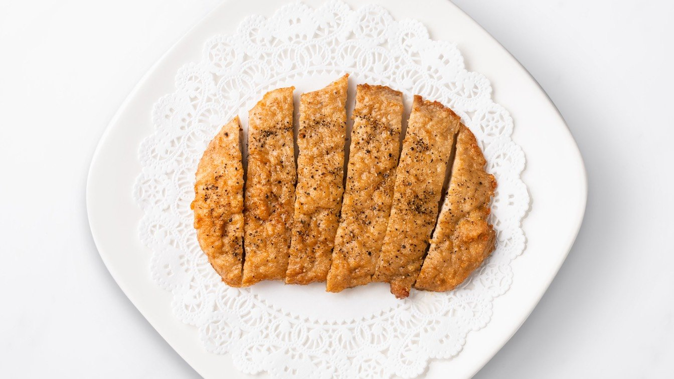 Sliced Fried Pork Chop on a white plate