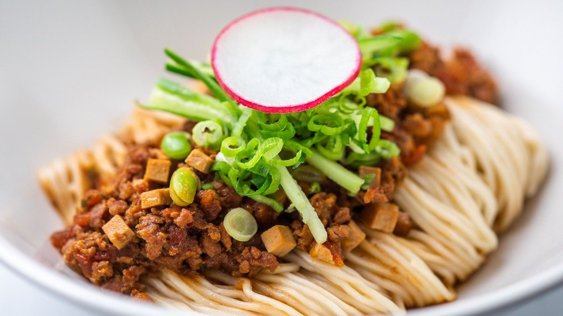 Noodles with Minced Kurobuta Pork Sauce in a white bowl
