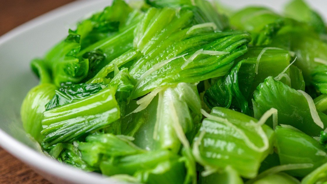 Sauteed Mustard Greens with Shredded Ginger Steamer in a white bowl, detail