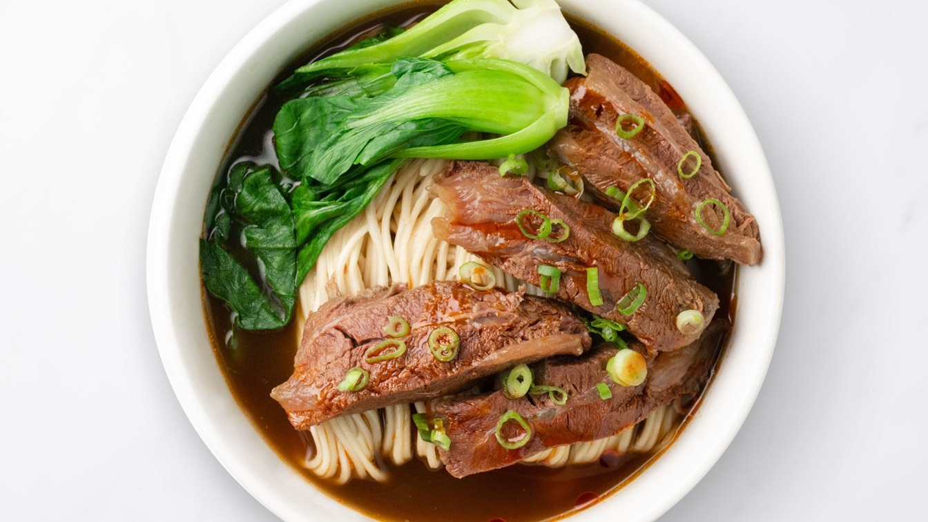 Braised Beef Noodle Soup in a white bowl