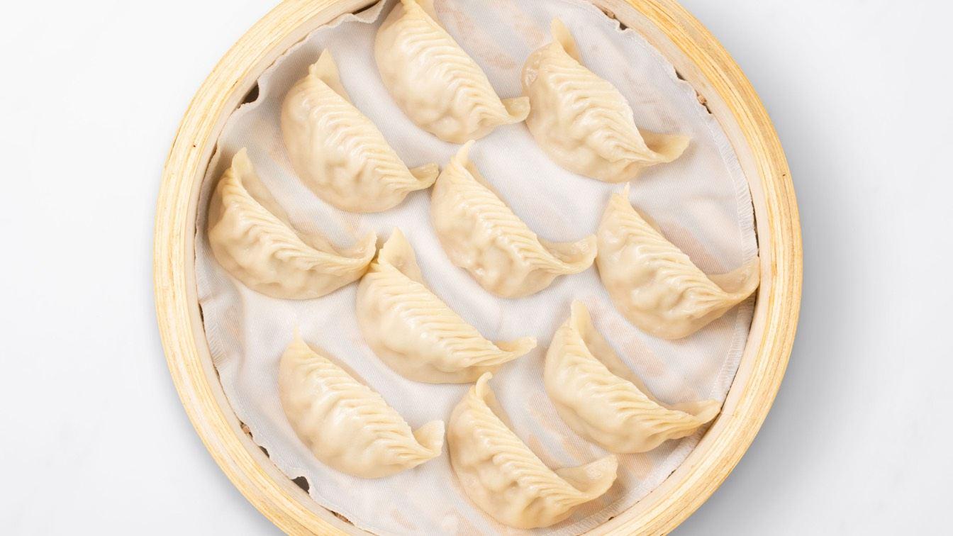 Jidori Chicken Dumplings in a steamer basket