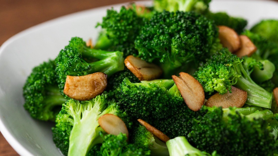 Sauteed Broccoli with Garlic in a white bowl, c
