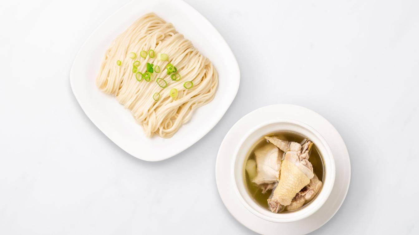 House Jidori Chicken Noodle Soup (Steamed) House Beef Noodle Soup (Steamed) in a white bowl and a plate of noodles