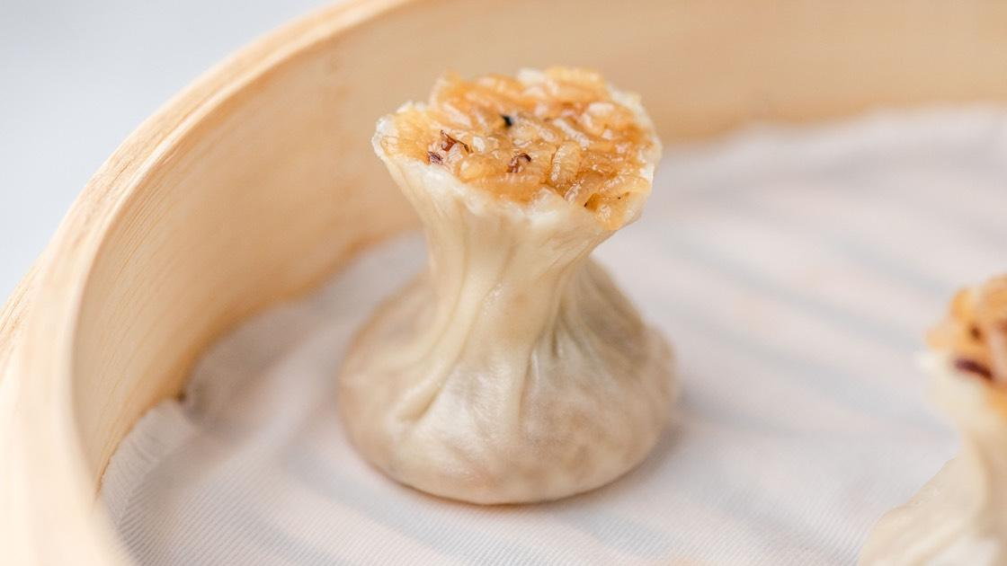 Sticky Rice & Kurobuta Pork Shao Mai in a steamer basket, close up