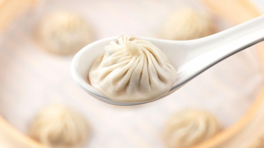 Soup dumpling in a spoon.