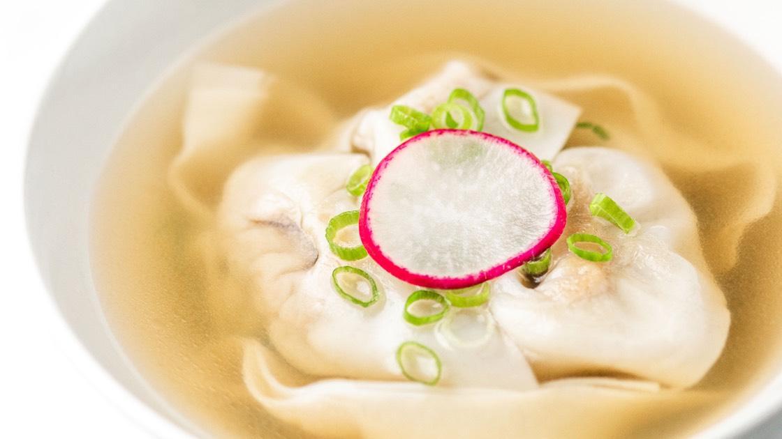 Jidori Chicken Wonton Soup in a white bowl, close up