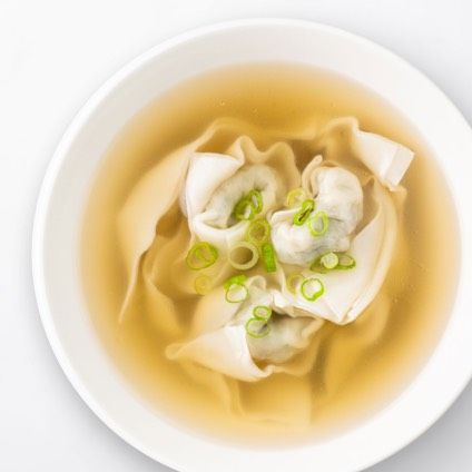 Vegetable & Kurobuta Pork Wonton Soup in a white bowl