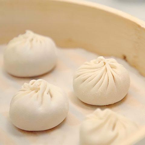 Soup dumplings ready to be steamed.