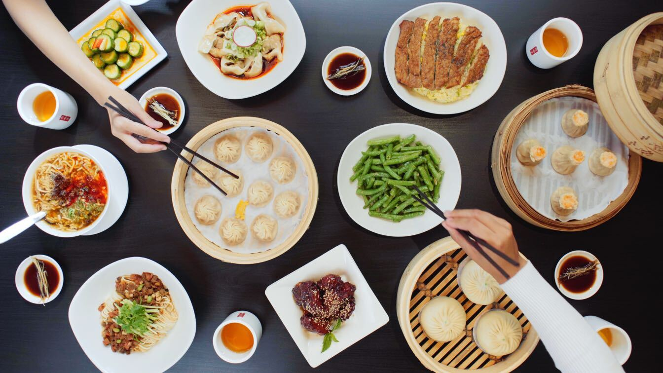 A table full of food, served family-style.