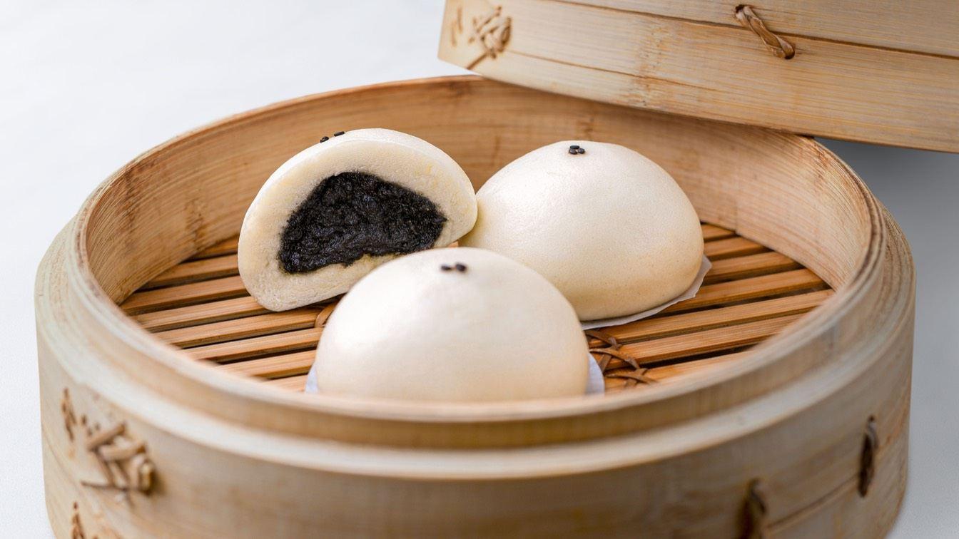 Sesame Bun in a steamer basket