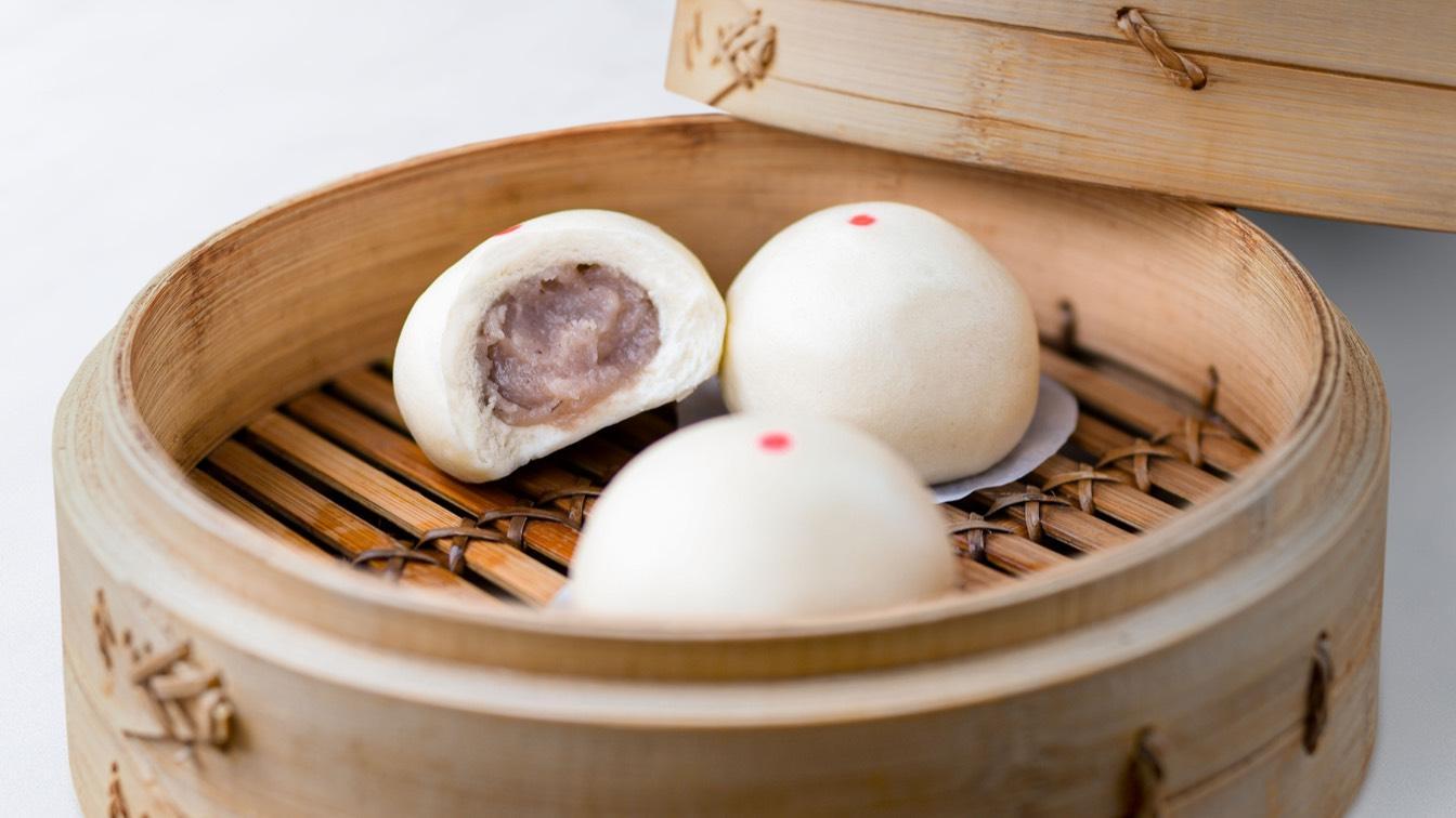 Sweet Taro Bun in a steamer basket