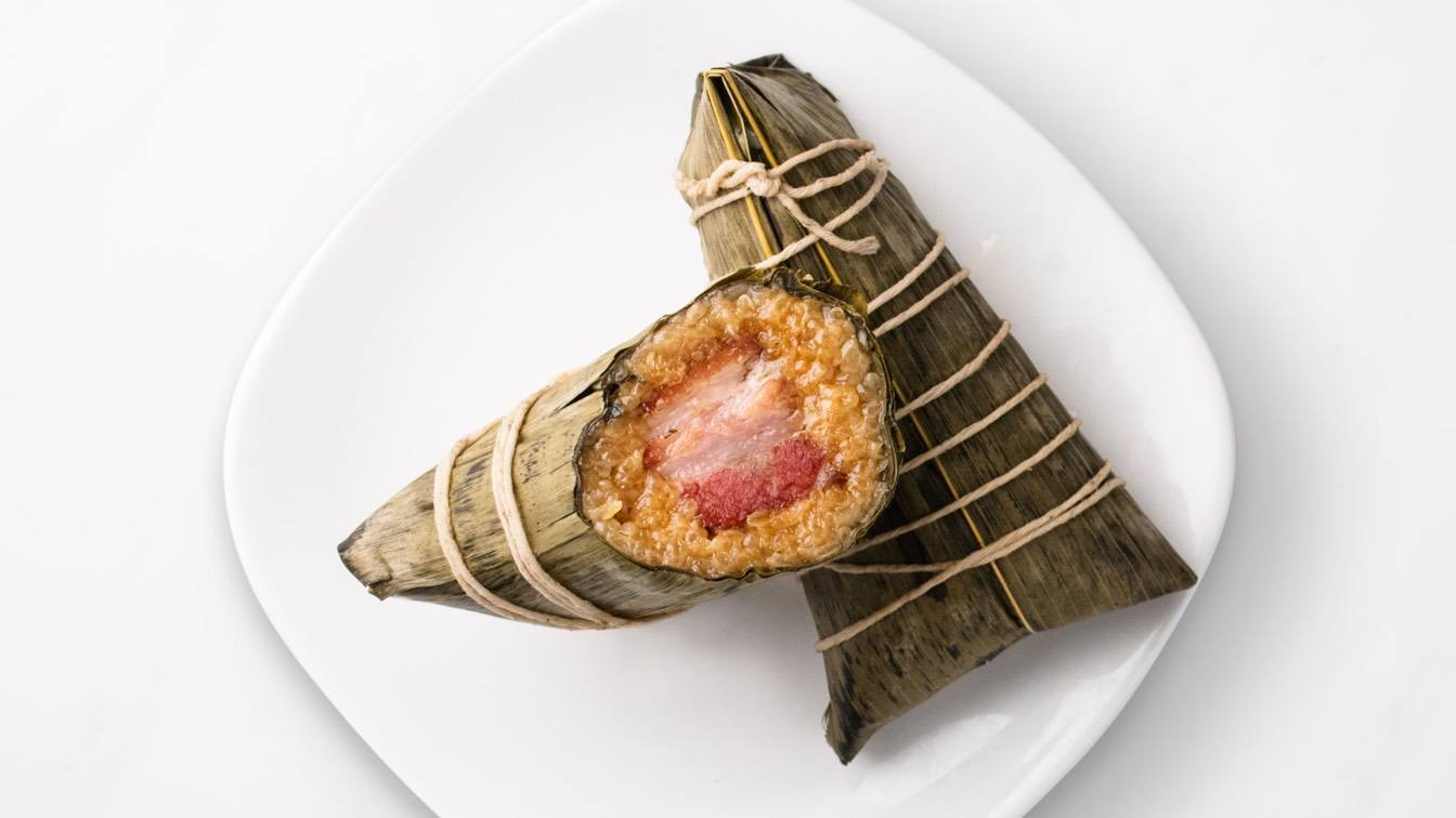 Kurobuta Pork Sticky Rice Wraps laid on a white plate