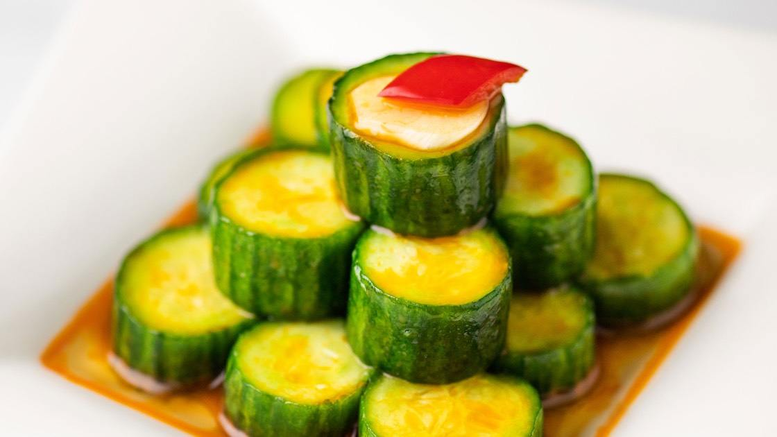 Cucumber Salad on white plate, close up