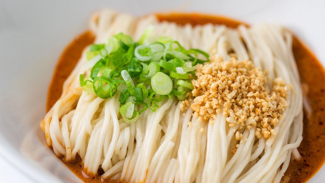 Noodles with Sesame Sauce in a white bowl, close up