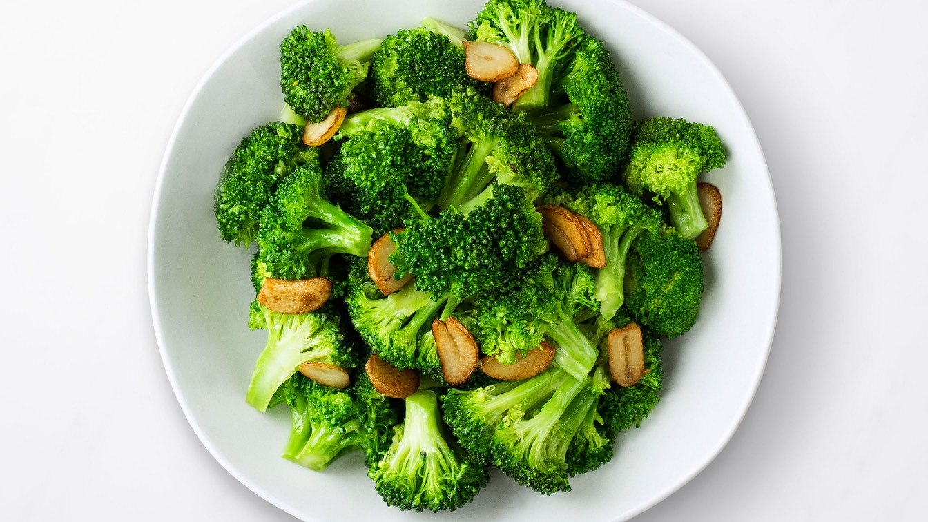 Sauteed Broccoli with Garlic in a white bowl