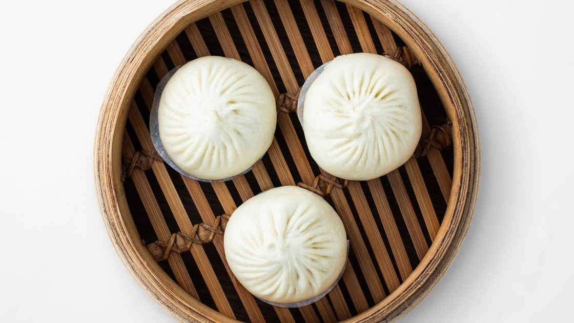 Kurobuta Pork Bun in a steamer basket, aerial view