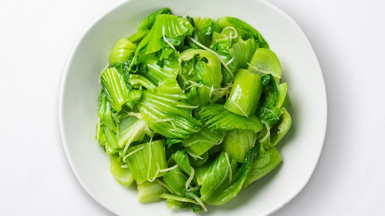 Sauteed Mustard Greens with Shredded Ginger Steamer in a white bowl