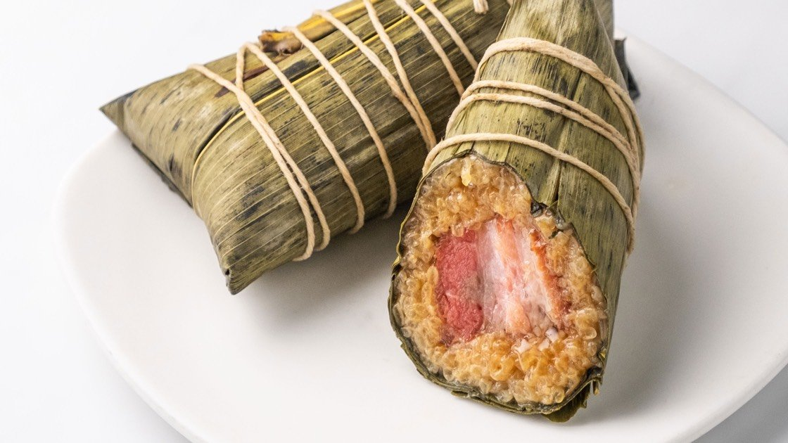 Kurobuta Pork Sticky Rice Wraps laid on a white plate, close up