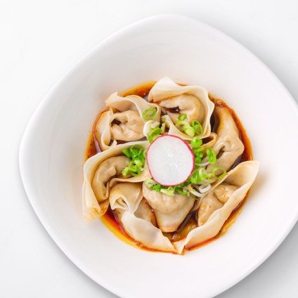 Jidori Chicken Wontons with Spicy Sauce in a white bowl