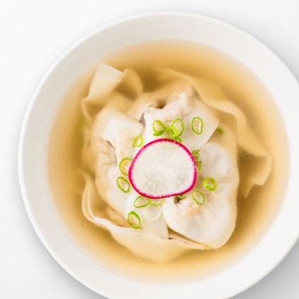 Jidori Chicken Wonton Soup in a white bowl