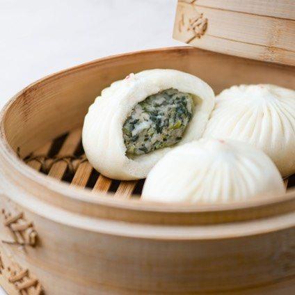 Vegetable & Kurobuta Pork Bun in a steamer basket