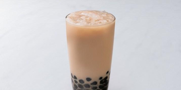 A photo of boba milk tea in a glass.
