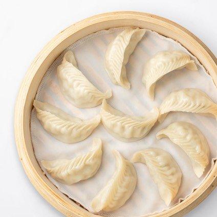 Steamed Cod Dumplings in a steamer basket