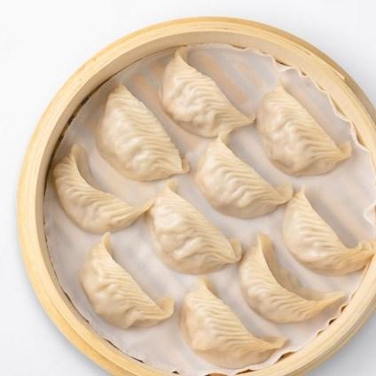 Shrimp & Kurobuta Pork Dumplings in a steamer basket