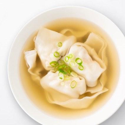 Shrimp & Kurobuta Pork Wonton Soup in a white bowl