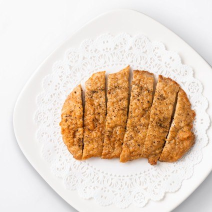 Sliced Fried Pork Chop on a white plate