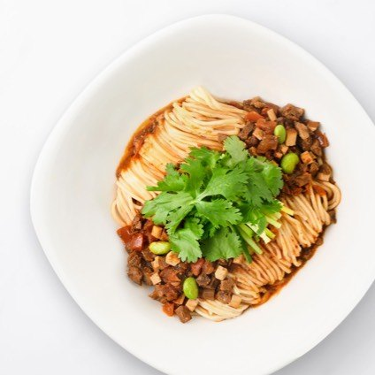Noodles with Diced Beef & Szechuan Peppers in a white bowl