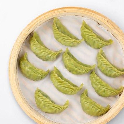 Vegetable & Mushroom Dumplings in a steamer basket