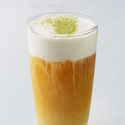 A photo of a sea salt cream-topped black Tea in a glass.