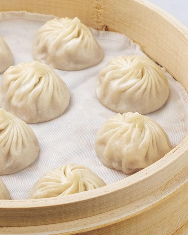 Soup dumplings in a bamboo basket.