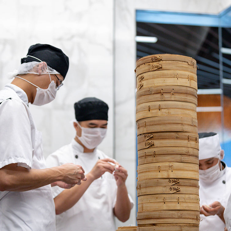 Din Tai Fung staff making dumplings