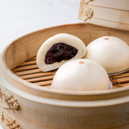 Chocolate buns in a bamboo basket.