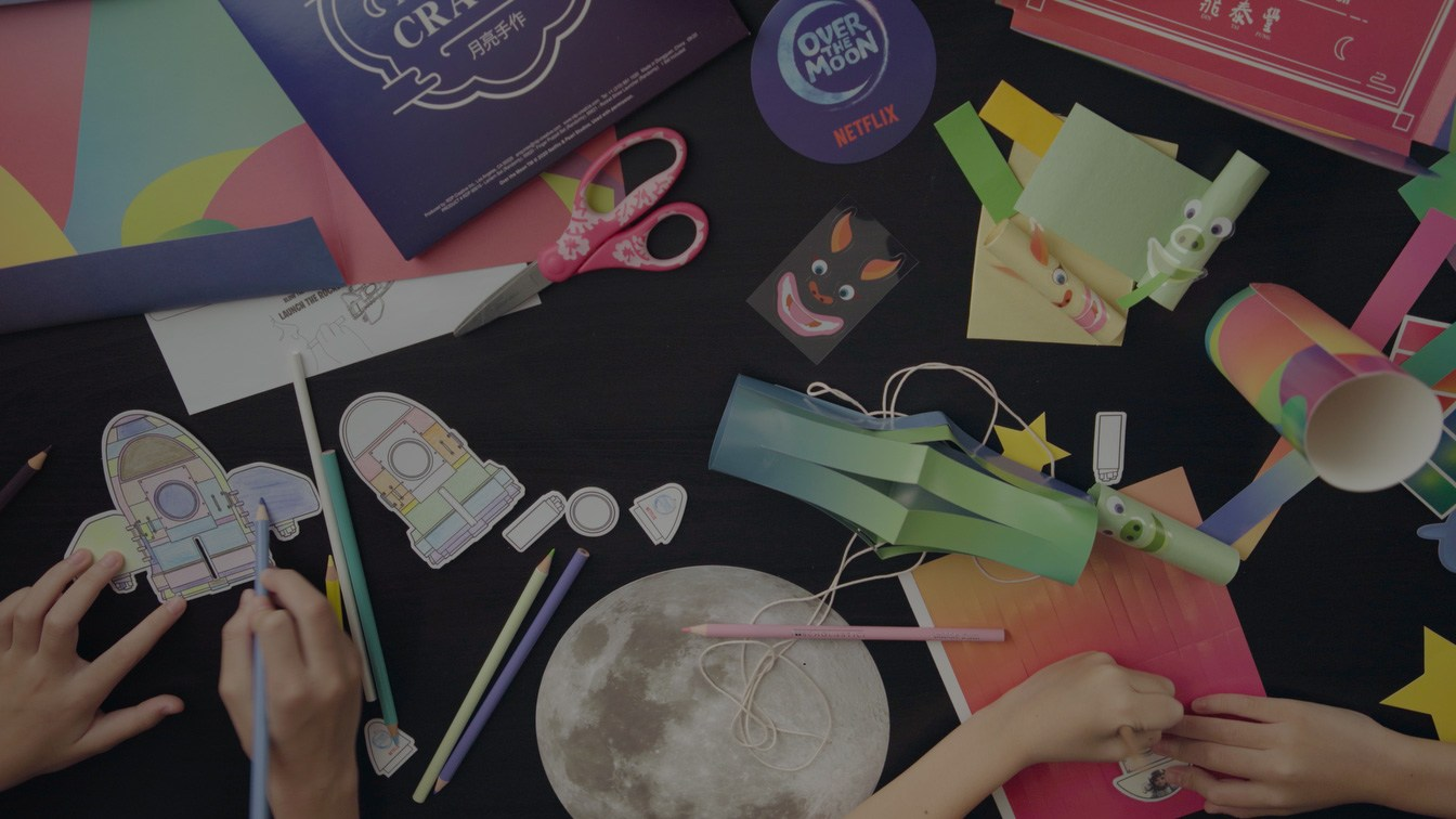 A still of kids playing with the Moon Crafts.