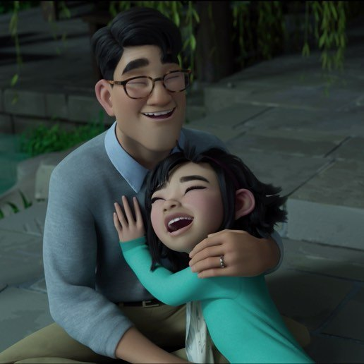 An animated still from Over the Moon depicting Fei Fei and her father laughing and hugging.