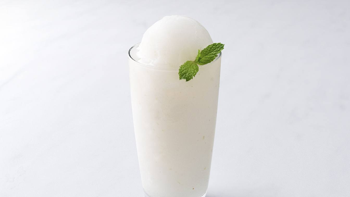 A photo of a lychee slush in a glass.