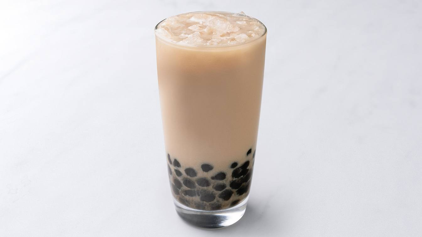 A photo of boba milk tea in a glass.