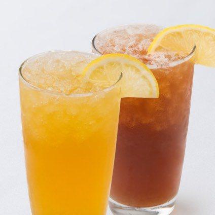 A photo of two glasses of iced fresh lemon green tea and fresh lemon black tea.