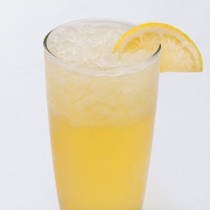 A photo of ice honey lemonade with a lemon slice garnish in a glass.