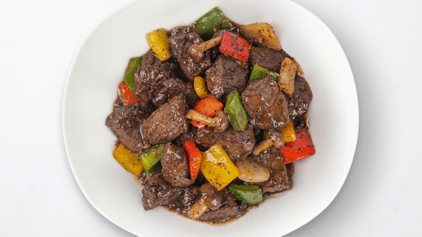 Wagyu Black Pepper Tenderloin in white dish